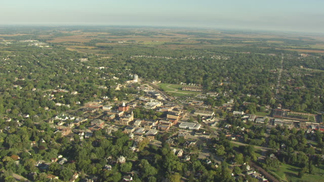 WS AERIAL POV View of large landscape with town / Woodstock, Illinois, United States