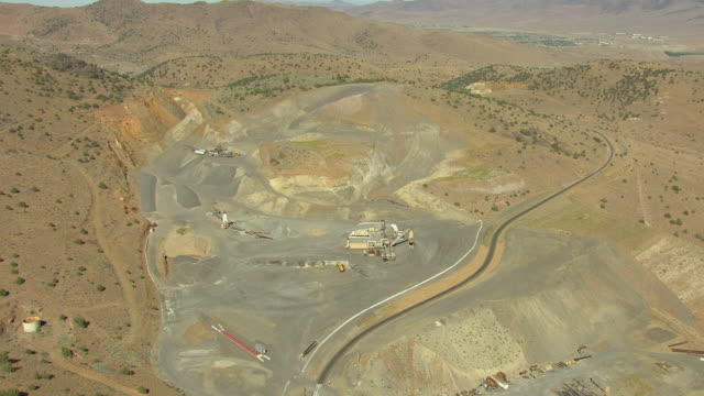 ws aerial view of large pit mine in storey county in bright sunshine / nevada, united states - pit mine stock videos and b-roll footage