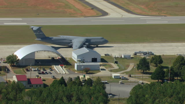 WS AERIAL View of large US Airforce plane sitting on tarmac / Huntsville, Alabama, United States