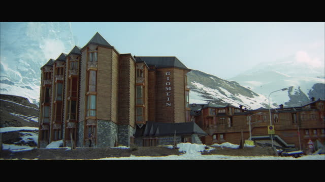 WS View of large wooden ski lodge with sign 'GIOMEIN'