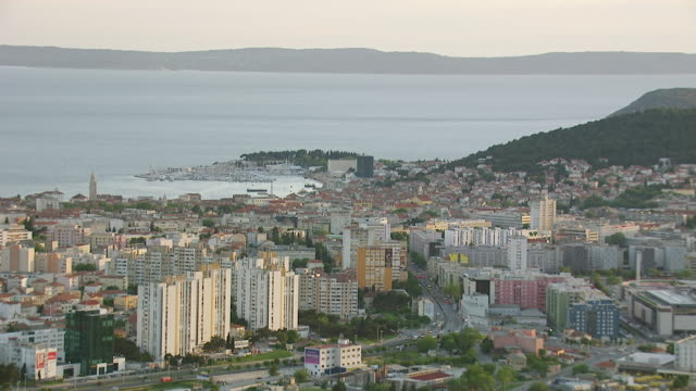 MS AERIAL View of largest coastal city under yellow sunlight / Split, Split Dalmatia County, Croatia