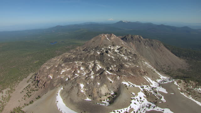 WS AERIAL POV View of Lassen Volcanic National Park with Lassen Peak and Chaos Crags and Mount Shasta in background / California, United States