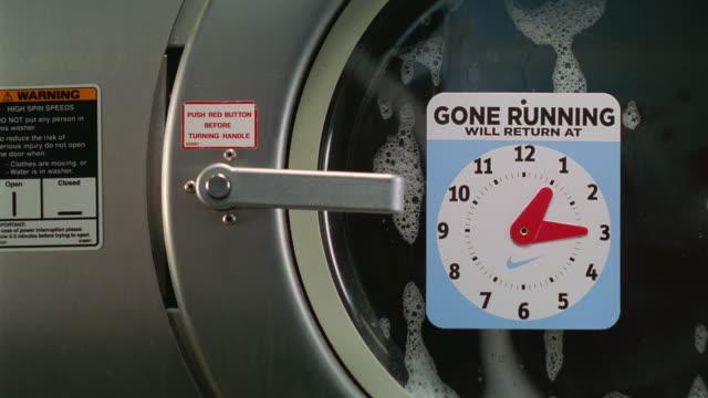 vídeos y material grabado en eventos de stock de cu view of laundry machine handle /new york, new york, united states - hacer la colada