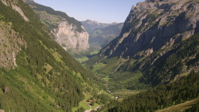 WS AERIAL TS View of Lauterbrunnen valley with hamlet lengwald and murrenflue rock face / Lautebrunnen Valley, Bern, Switzerland