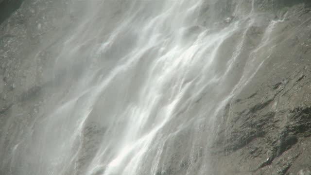 ms view of lauterbrunnen waterfall at lauterbrunnen  valley / lauterbrunnen, bernese alps, switzerland - berner alpen stock-videos und b-roll-filmmaterial
