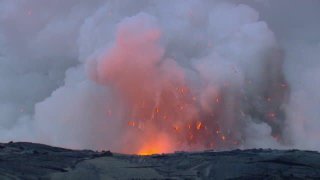 WS SLO MO View of lava exploding with smoke / Mauna Kea, Hawaii, United States