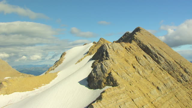 WS AERIAL View of ledge of Sperry Glacier in Glacier National Park / Montana, United States