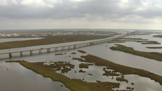 ws aerial view of leeville bridge and section of highway la 1 / louisiana, united states - bayou lafourche stock-videos und b-roll-filmmaterial