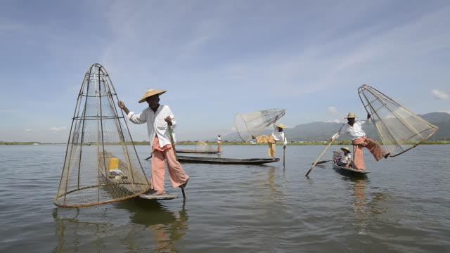 MS View of Leg rowing Intha fishermen fishing / Nyaungshwe, Shan State, Myanmar