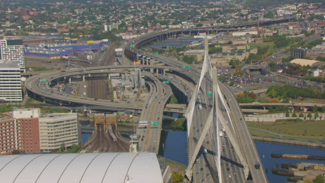 WS AERIAL POV View of Leonard P. Zakim Bunker Hill Bridge and TD Garden with city / Boston, Massachusetts, United States
