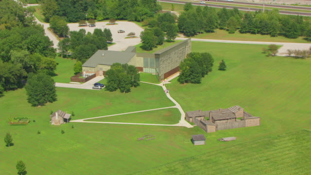 ws aerial pov view of lewis & clark state historic site, tourist walking along camp path / hartford, madison county, illinois, united states - 探検家 ウィリアム・クラーク点の映像素材/bロール