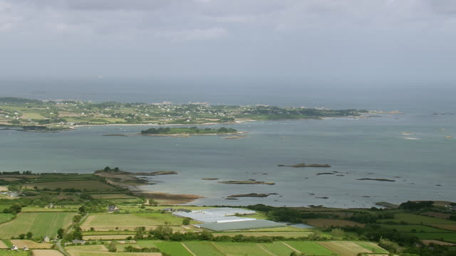 WS AERIAL View of Lezardrieux with farm field and sea / Brittany, France