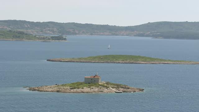 ws aerial view of light house in adriatic sea / korcula, dubrovnik neretva county, croatia - adriatic sea stock videos & royalty-free footage