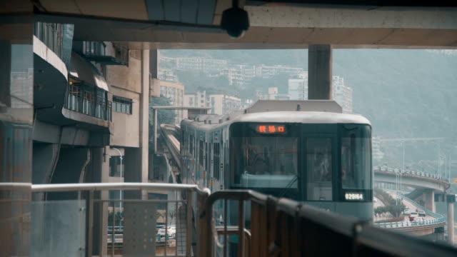 view of light rail in chongqing,china. - einschienenbahn stock-videos und b-roll-filmmaterial
