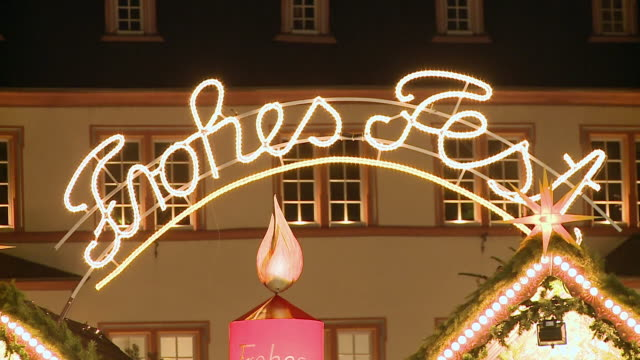 ms view of light sign on shop top / trier, rhineland-palatinate, germany - shop sign stock videos & royalty-free footage