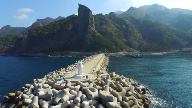 stockvideo's en b-roll-footage met view of lighthouse at hyeonpo-port, ulleungdo island, south korea - voor anker gaan
