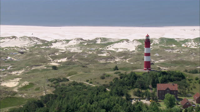 ws aerial view of lighthouse / foehramrum, schleswig-holstein, germany - schleswig holstein stock videos & royalty-free footage