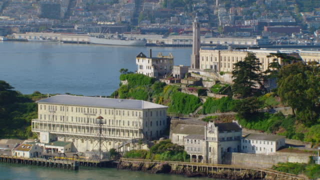 ws ds aerial view of lighthouse of alcatraz island and prison complex / san francisco, california, united states - alcatraz island stock videos & royalty-free footage