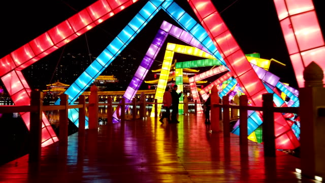 view of lighting show in tang paradise city for celebrate chinese spring festival / xi'an, shaanxi, china - fairground stock videos and b-roll footage