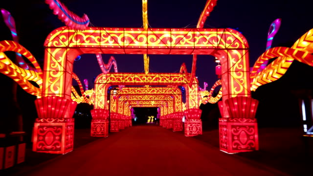 view of lighting show in tang paradise city for celebrate chinese spring festival / xi'an, shaanxi, china - chinese new year stock videos & royalty-free footage