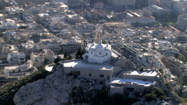 ws aerial zo view of likavitus cityscape and lycabettus mountain with saint george chapel on top. wide shot over athens /  likavitus, lycabettus, athens, greece - chapel stock videos & royalty-free footage