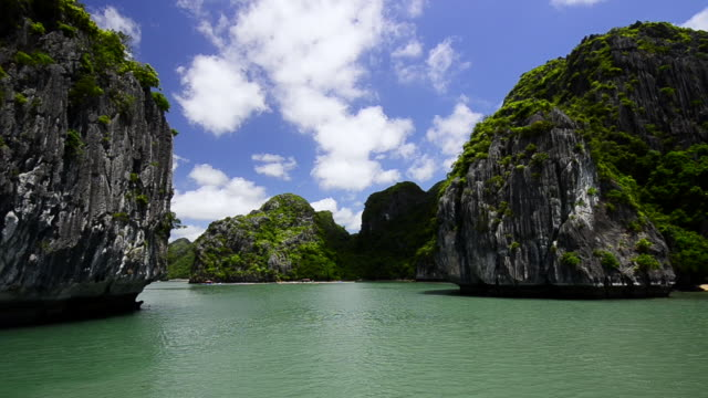 ws pov view of limestone outcrops at halong bay / ha long bay, viet nam - halong bay stock videos and b-roll footage