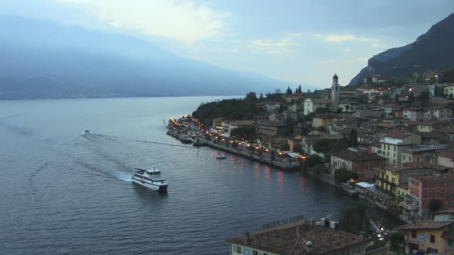 ws, ha, view of limone sul garda lake shore at dusk, lake garda, sirmione, lombardy, italy - italy stock videos & royalty-free footage