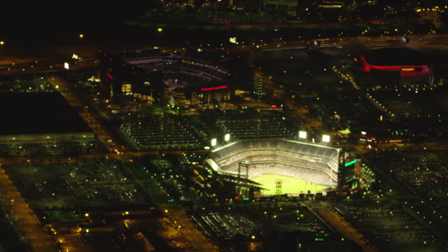 ms aerial view of lincoln financial field and citizen bank park at night / philadelphia  - stabilimento sportivo video stock e b–roll
