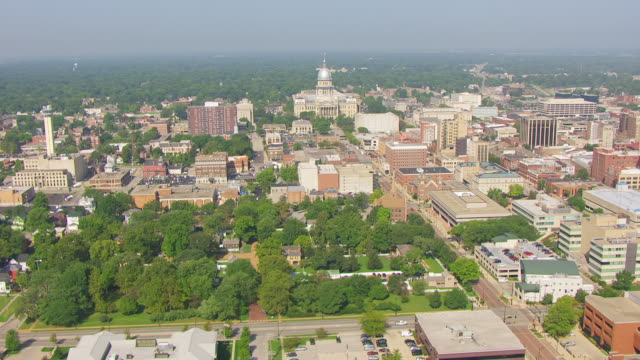WS AERIAL POV View of Lincoln Home and downtown with capitol building in background / Springfield, Illinois, United States