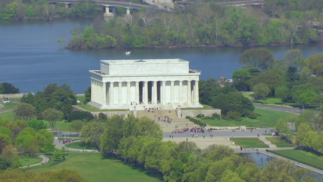 ws aerial pov view of lincoln memorial and washington monument with cityscape / washington dc, united states - reflecting pool washington dc stock videos & royalty-free footage