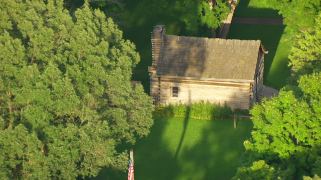 WS AERIAL POV View of Lincoln's first store at Lincoln's New Salem State Historic Site / Menard County, Illinois, United States