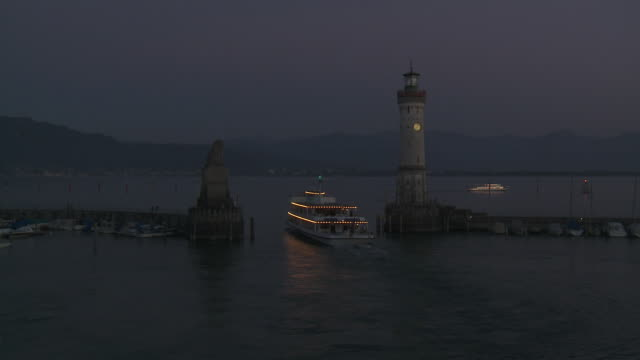 WS View of Lindau harbour entrance and lighthouse at night on Lake Constance / Lindau, Bavaria, Germany