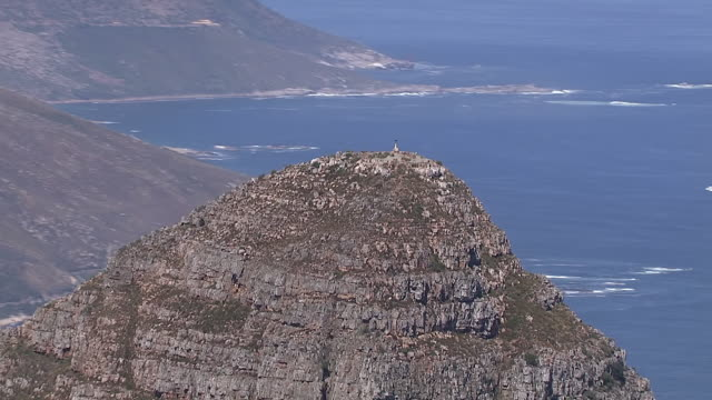 ws aerial ts view of lion's head and twelve apostles mountain range in cape town / cape town, western cape, south africa - lion's head mountain stock videos and b-roll footage