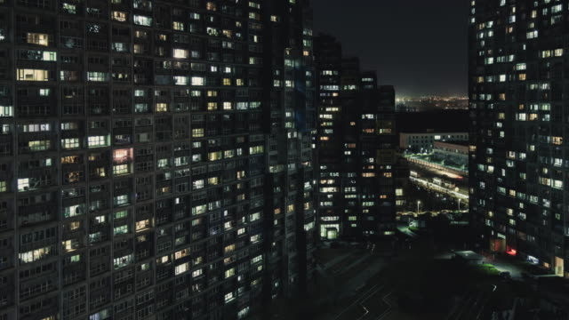 t/l tu view of living apartment at night / beijing, china - street light stock videos & royalty-free footage