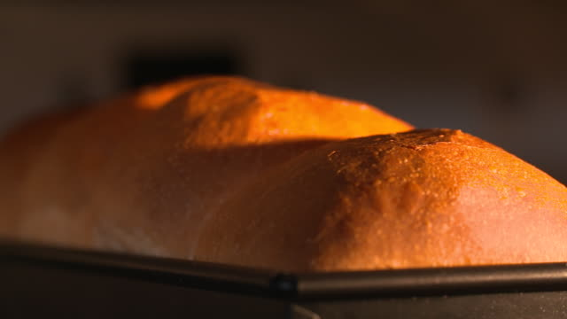 view of loaf of bread being baked on the oven - white bread stock videos and b-roll footage
