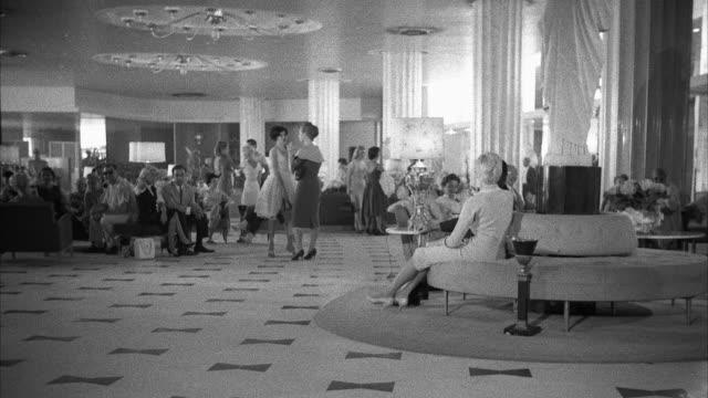vídeos de stock, filmes e b-roll de ws view of lobby of hotel fontainebleau - 1960