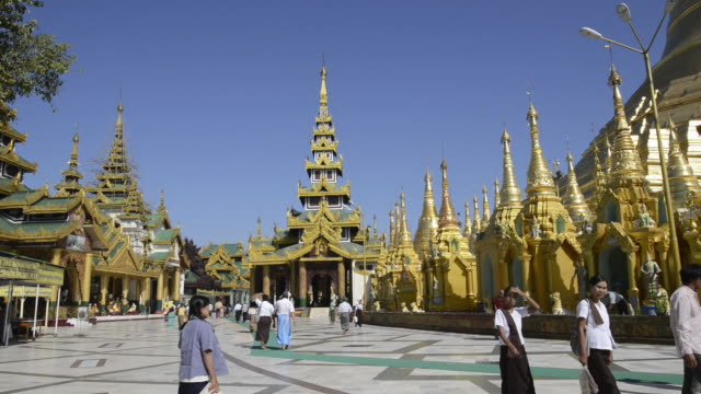 ws pan view of local people walking around golden stupa of famous shwedagon pagoda / yangon, yangon division, myanmar - stupa stock videos & royalty-free footage