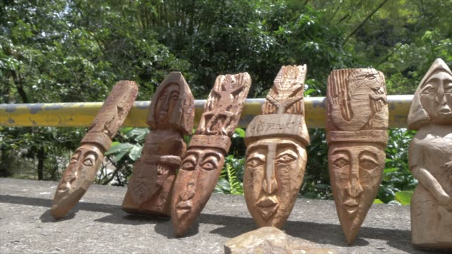 view of local souvenirs at entrance to toraille waterfall, st. lucia, windward islands, west indies caribbean, central america - st lucia stock videos & royalty-free footage