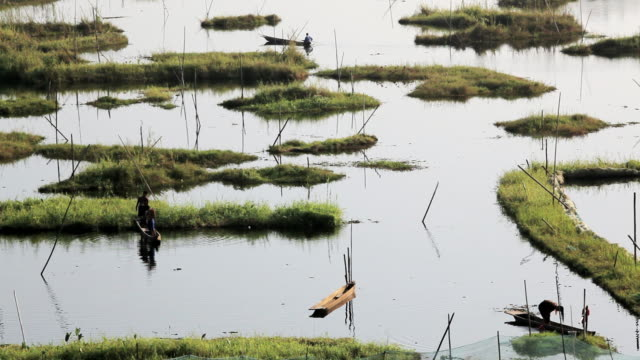 WS View of local workers Loktak Lake largest freshwater lake Impala /  Manipur, India