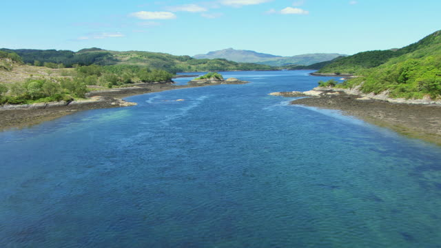 WS AERIAL TD View of Loch Teacuis on west coast passing over narrows to water / Morvern, Inverness Shire, Scotland
