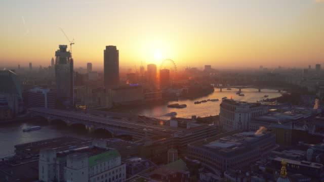 view of london at sunset with the thames and the london eye - millennium wheel stock videos and b-roll footage