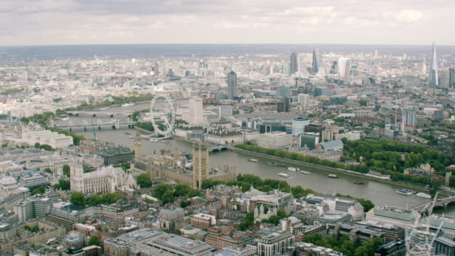 ws aerial pov view of london eye, big ben, thames river in cityscape / london, england, united kingdom - city of westminster london stock videos & royalty-free footage