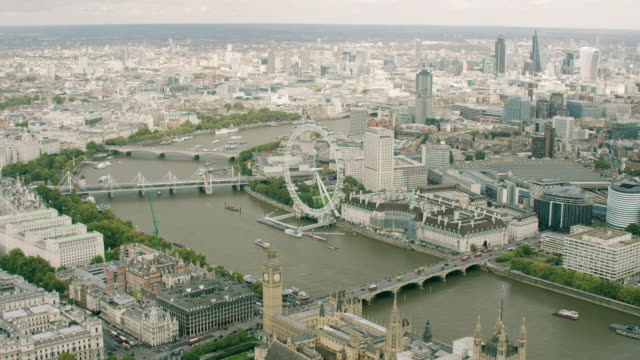 WS AERIAL POV View of London Eye, Big Ben, Thames River in cityscape / London, England, United Kingdom