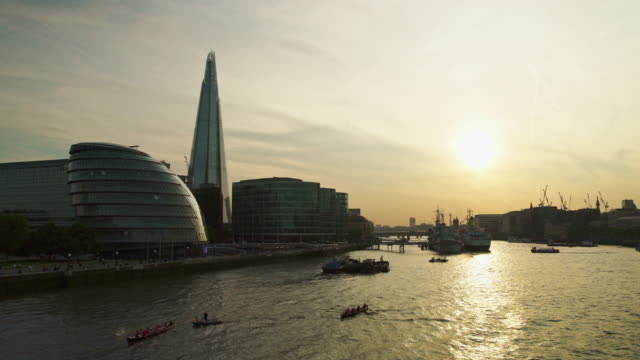 View of London with rowing boats on The Thames at sunset