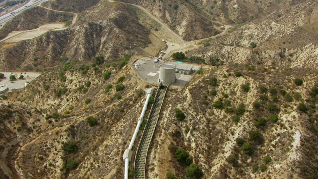 ws aerial pov view of los angeles aqueduct on top of cascades / los angeles, california, united states - aqueduct stock videos and b-roll footage