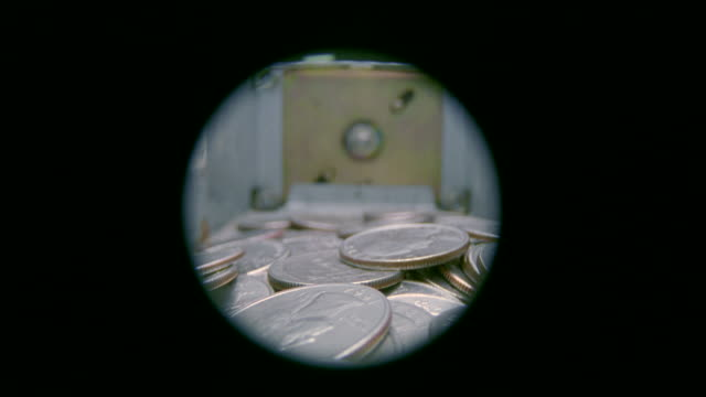 CU View of lots of coin in laundry machine /New York, New York, United States