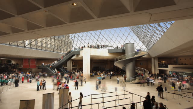 ws t/l view of louvre interior hall with spiral staircase / paris, france  - spiral staircase stock videos and b-roll footage