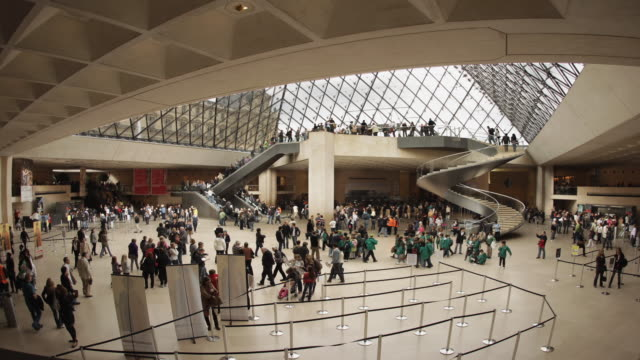 ws t/l view of louvre interior hall with spiral staircase / paris, france  - spiral staircase stock videos & royalty-free footage