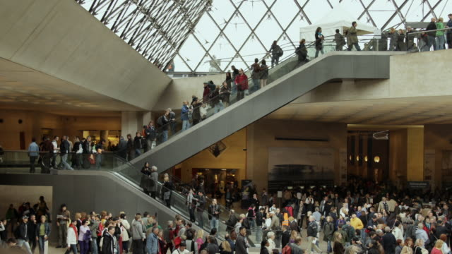 WS T/L View of Louvre interior hall with staircase / Paris, France