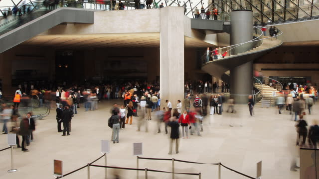 ws zo t/l view of louvre interior hall with staircase / paris, france  - museo video stock e b–roll